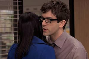 Ryan from The Office whispering into Kelly's ear