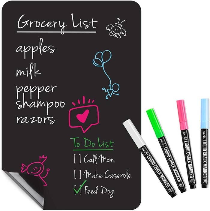 Flexible black dry erase board with white, gree, pink, and blue pens