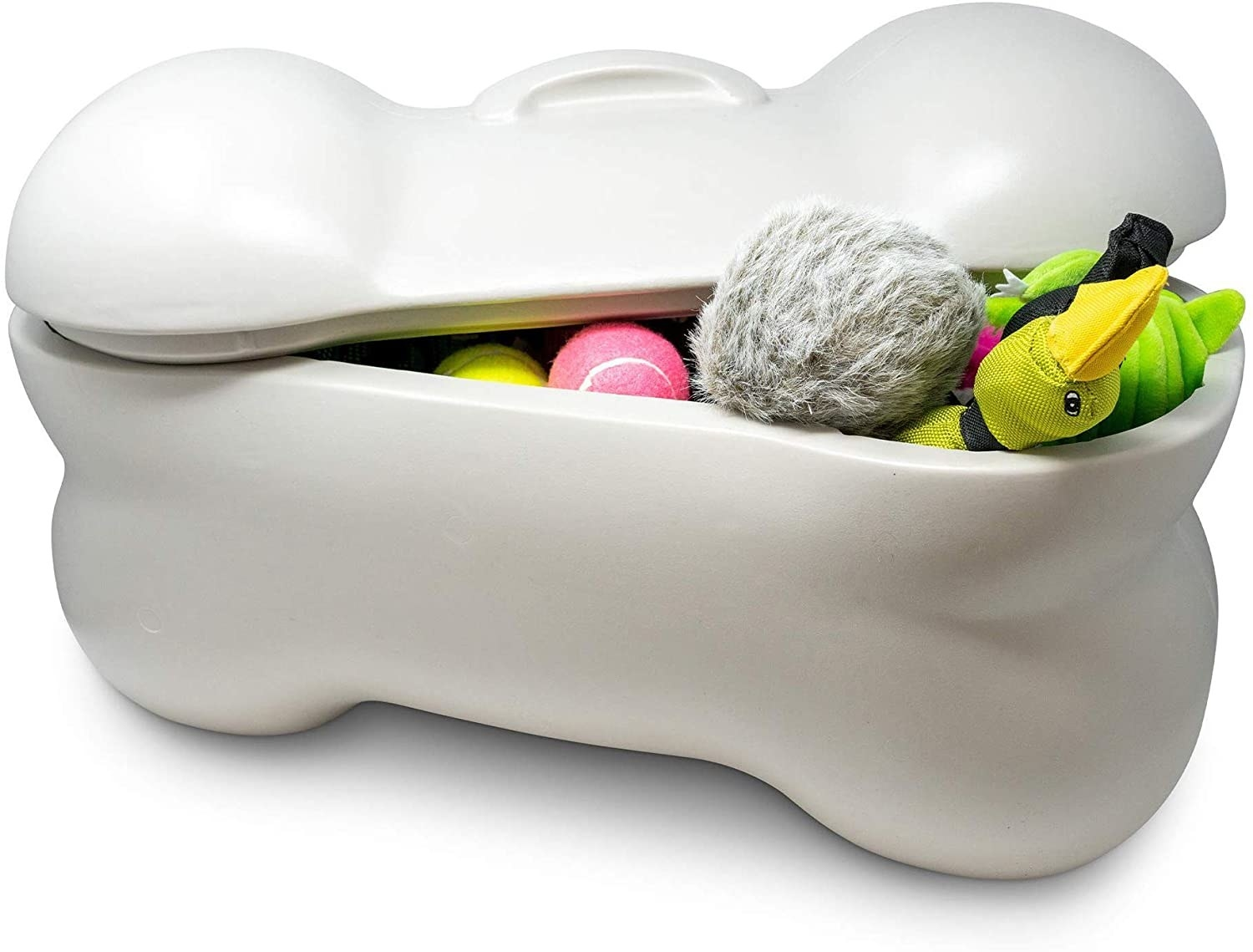 An off-white, bone-shaped plastic storage bin with lid open to reveal dog toys inside