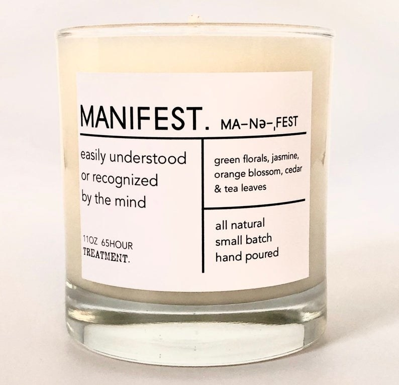 "A white candle that says ""Manifest"" and ""easily understood or recognized by the mind"""