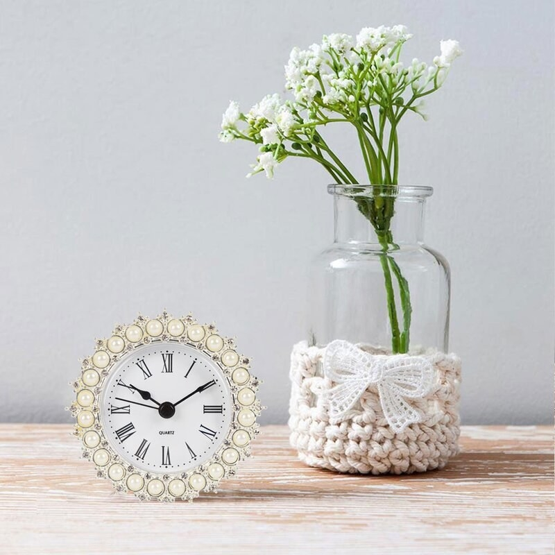 The pearl clock on wood table