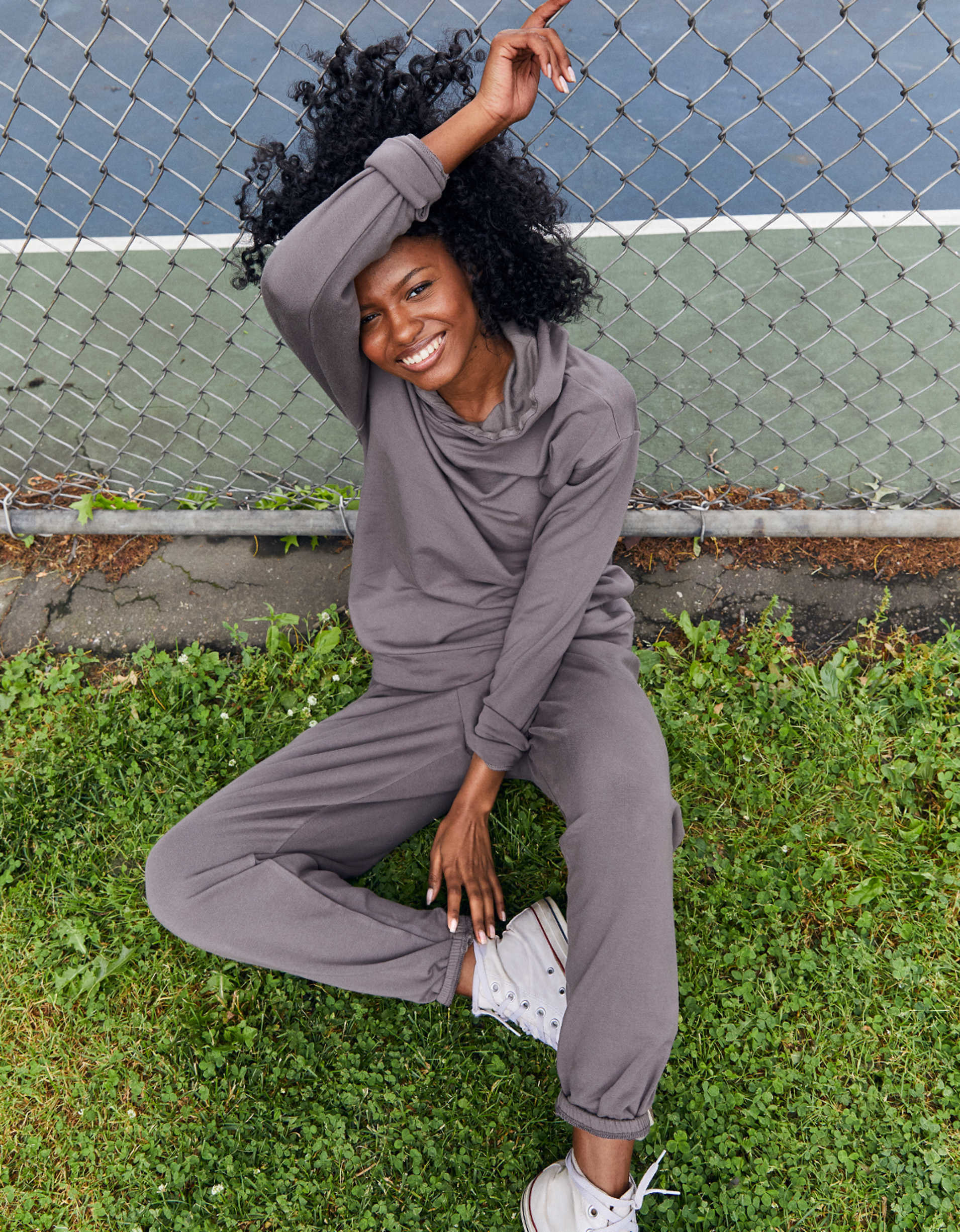Model wearing the sweatpants with an elastic waist and elastic around the ankles in dark grey