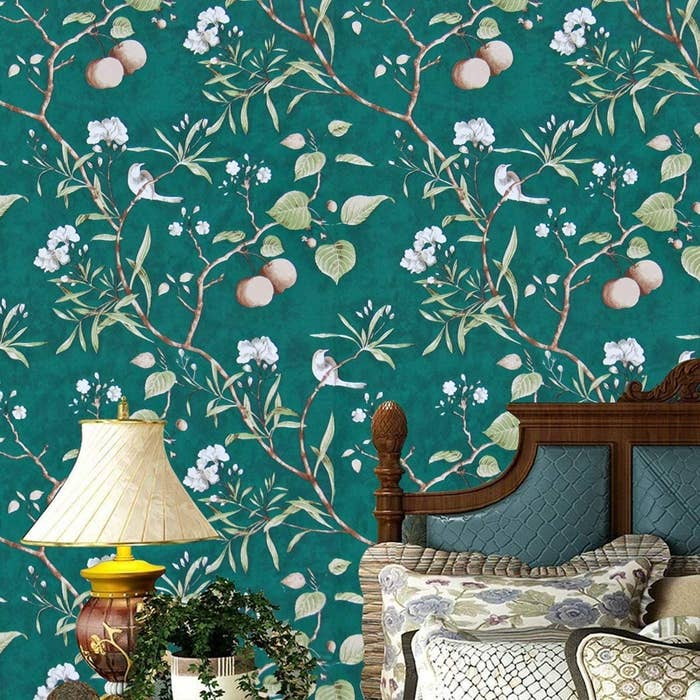 The dark emerald green wallpaper with white and pink floral and leaf designs