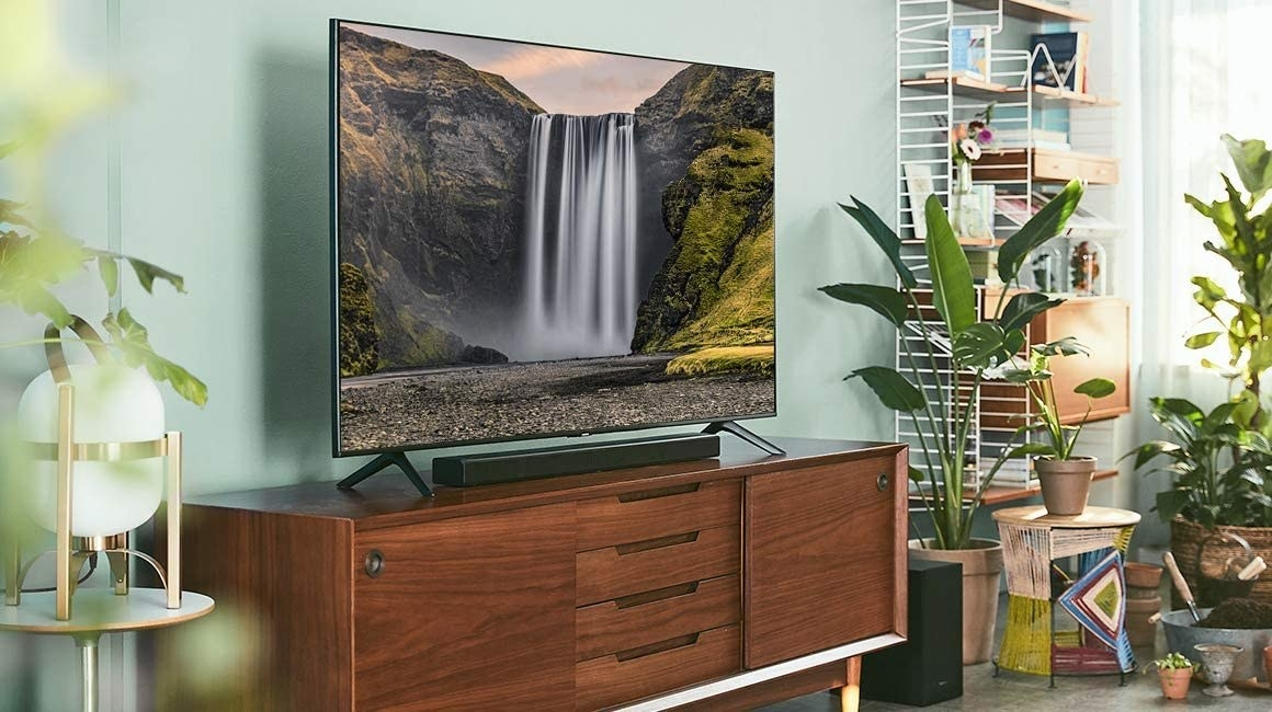 The sleek soundbar placed under a TV set