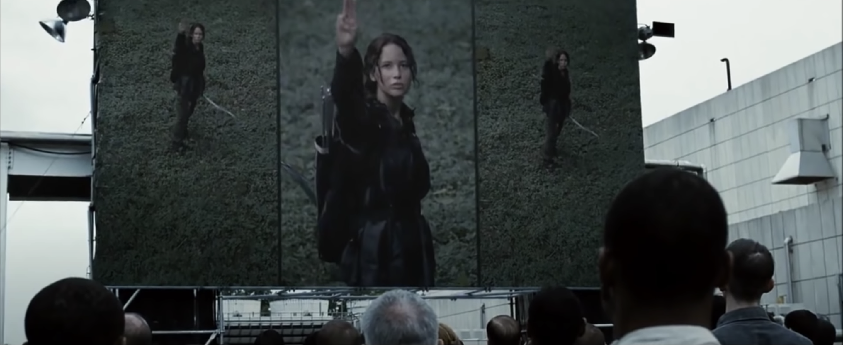 Katniss gives the Three Finger Salute