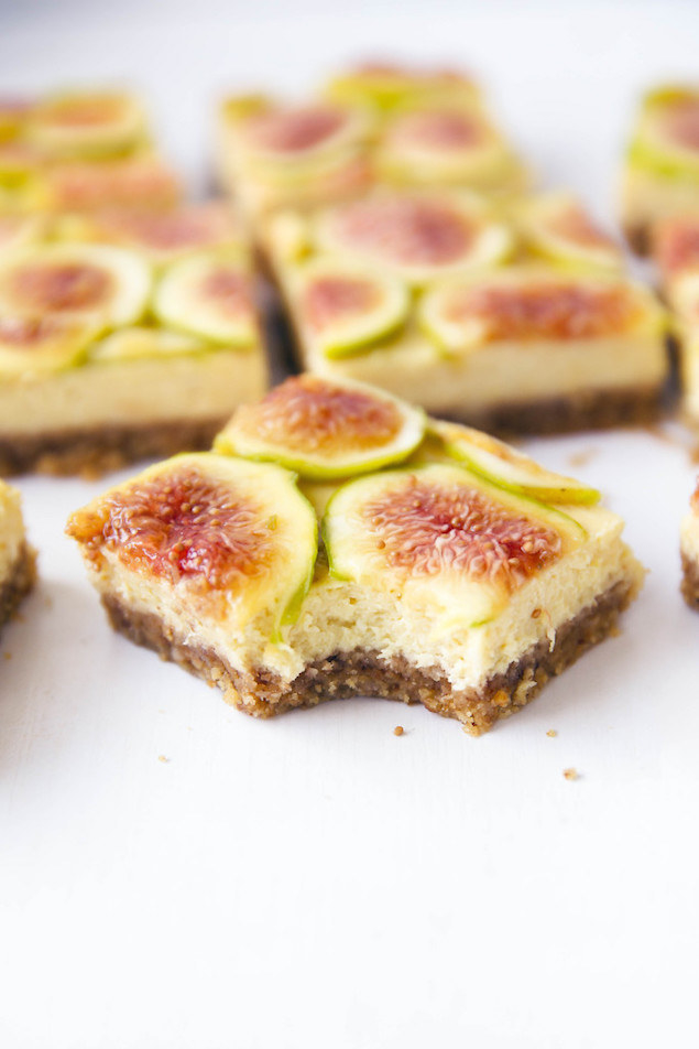 A slice of honey fig cheesecake with a bite taken out of it.