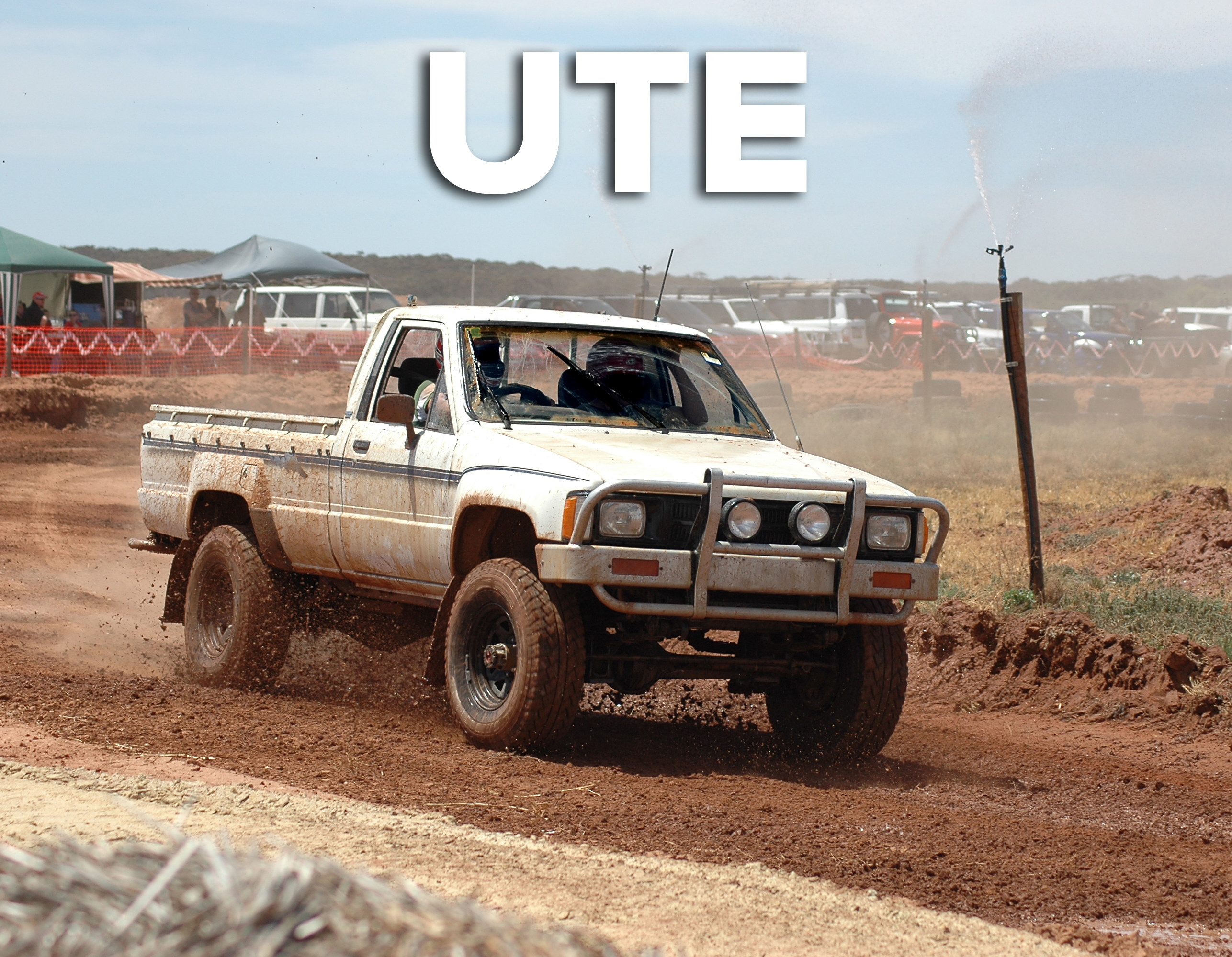 A utility truck (ute) parked on a dirt road