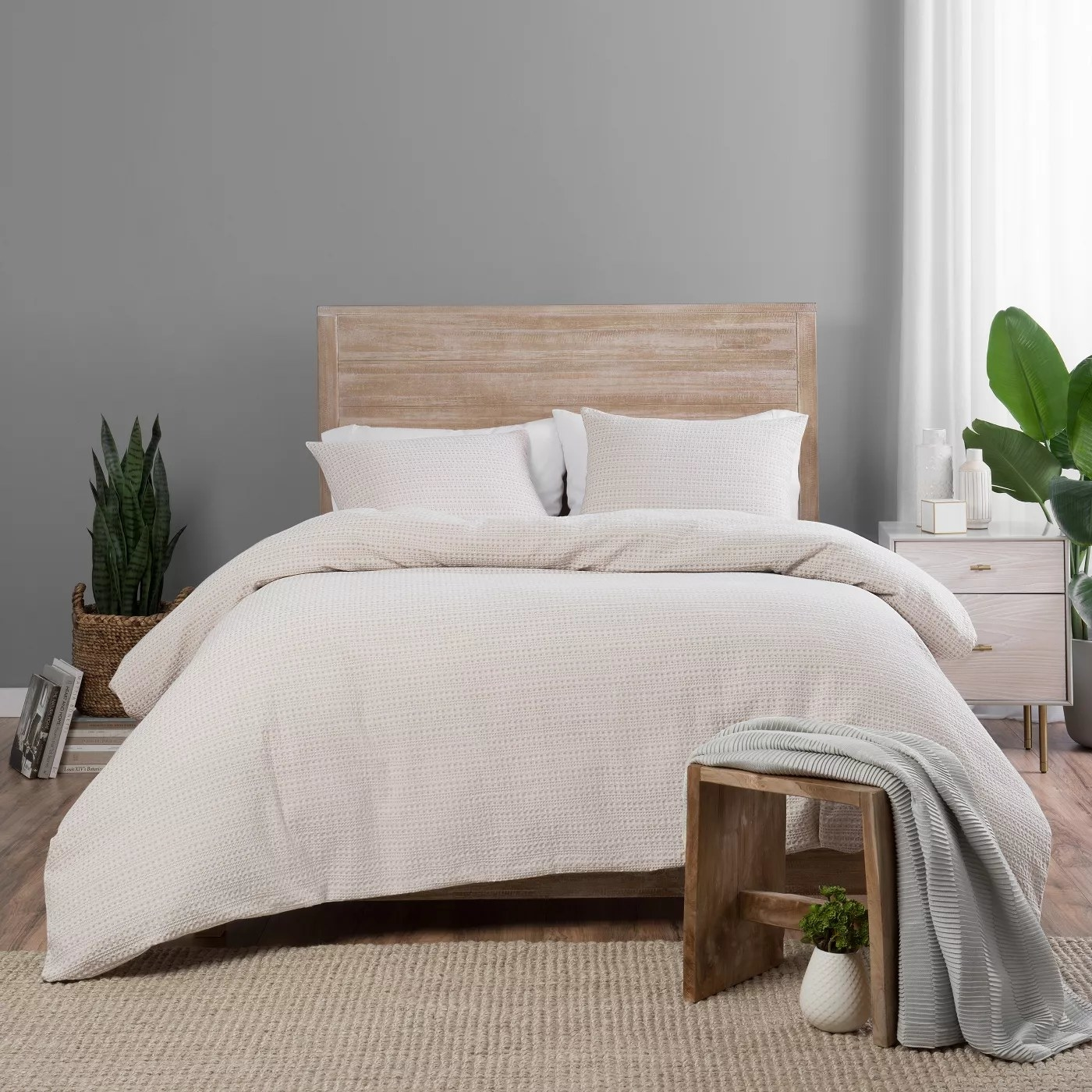 The taupe comforter and matching shams