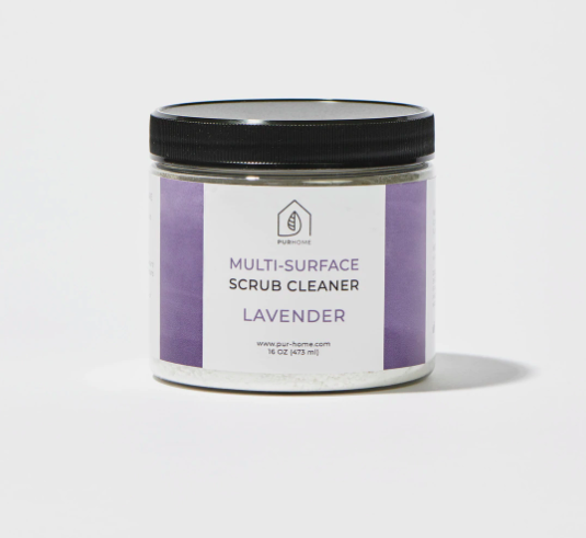 """Purple container that says """"PUR Home Multi-Surface Scrub Cleaner Lavender"""" on the front"""