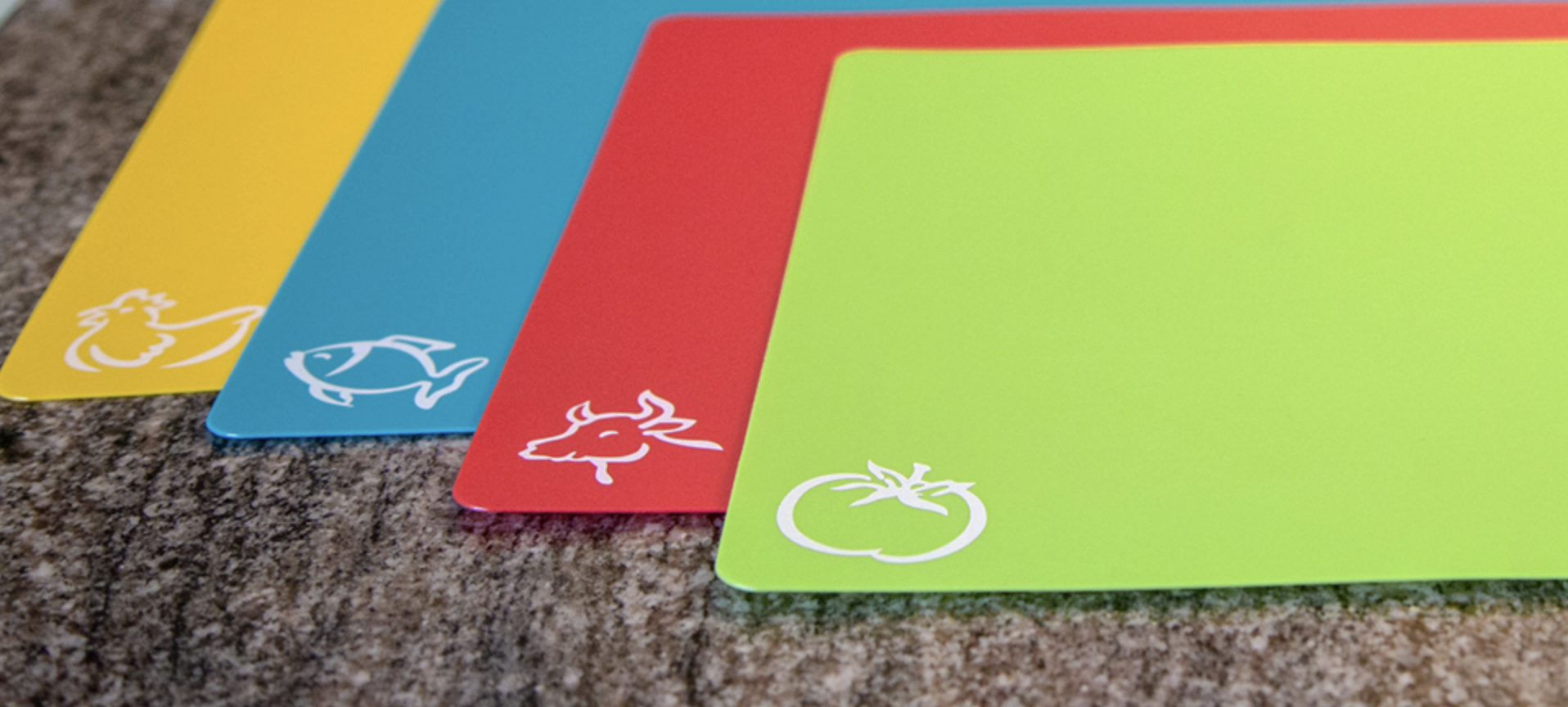 Yellow, blue, red, and green mats with different food labels