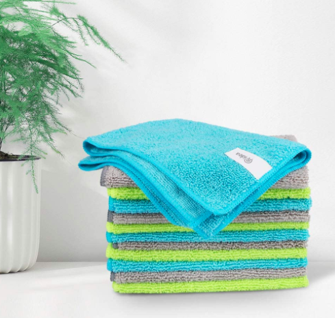 Blue, green, and gray microfiber cleaning cloths on the side of a table