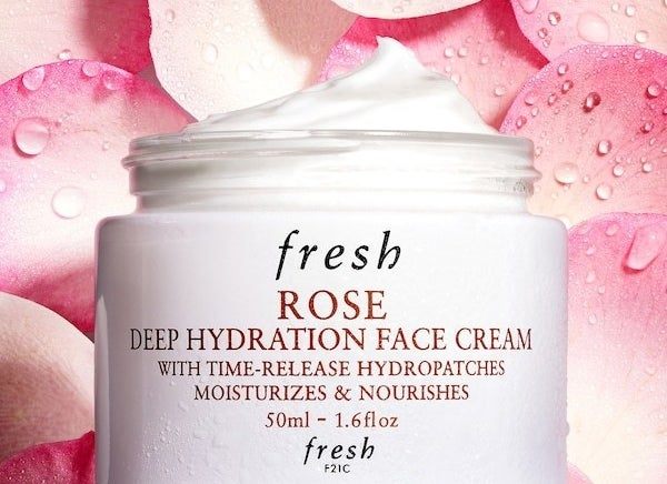 The tub of the face cream — the cream is white