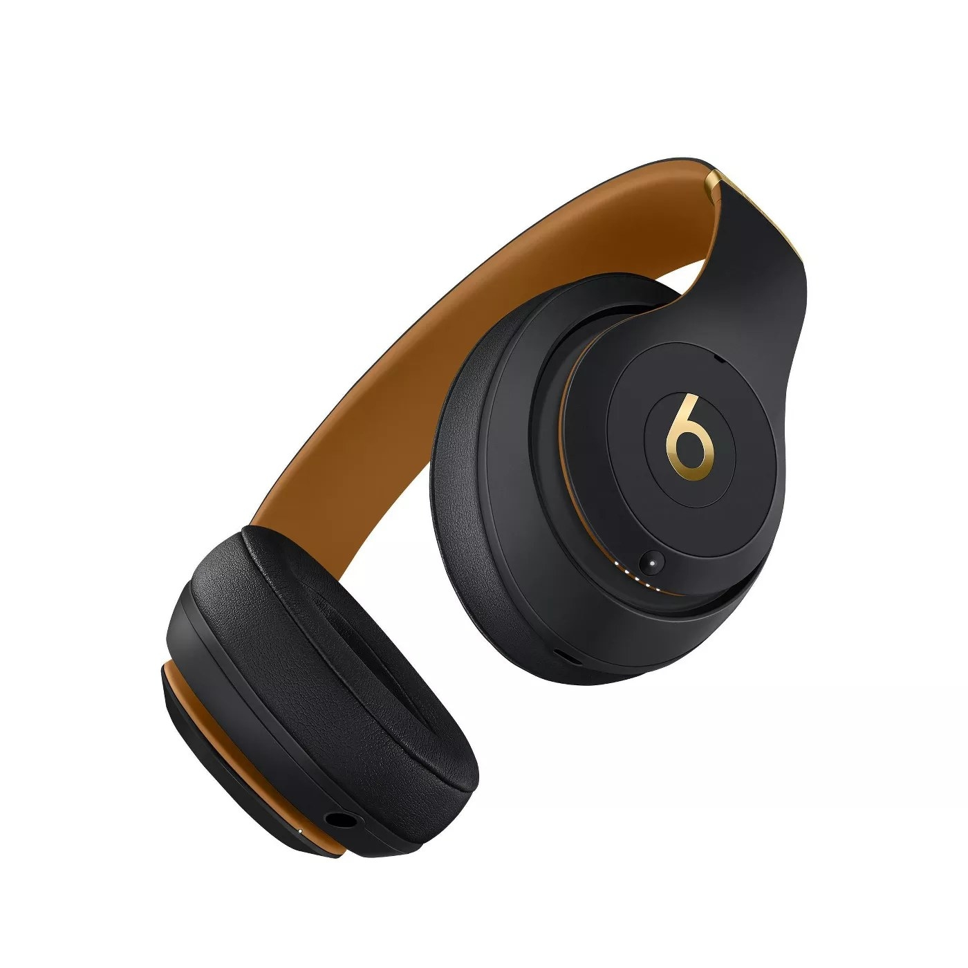 A black and gold pair of over-ear headphones