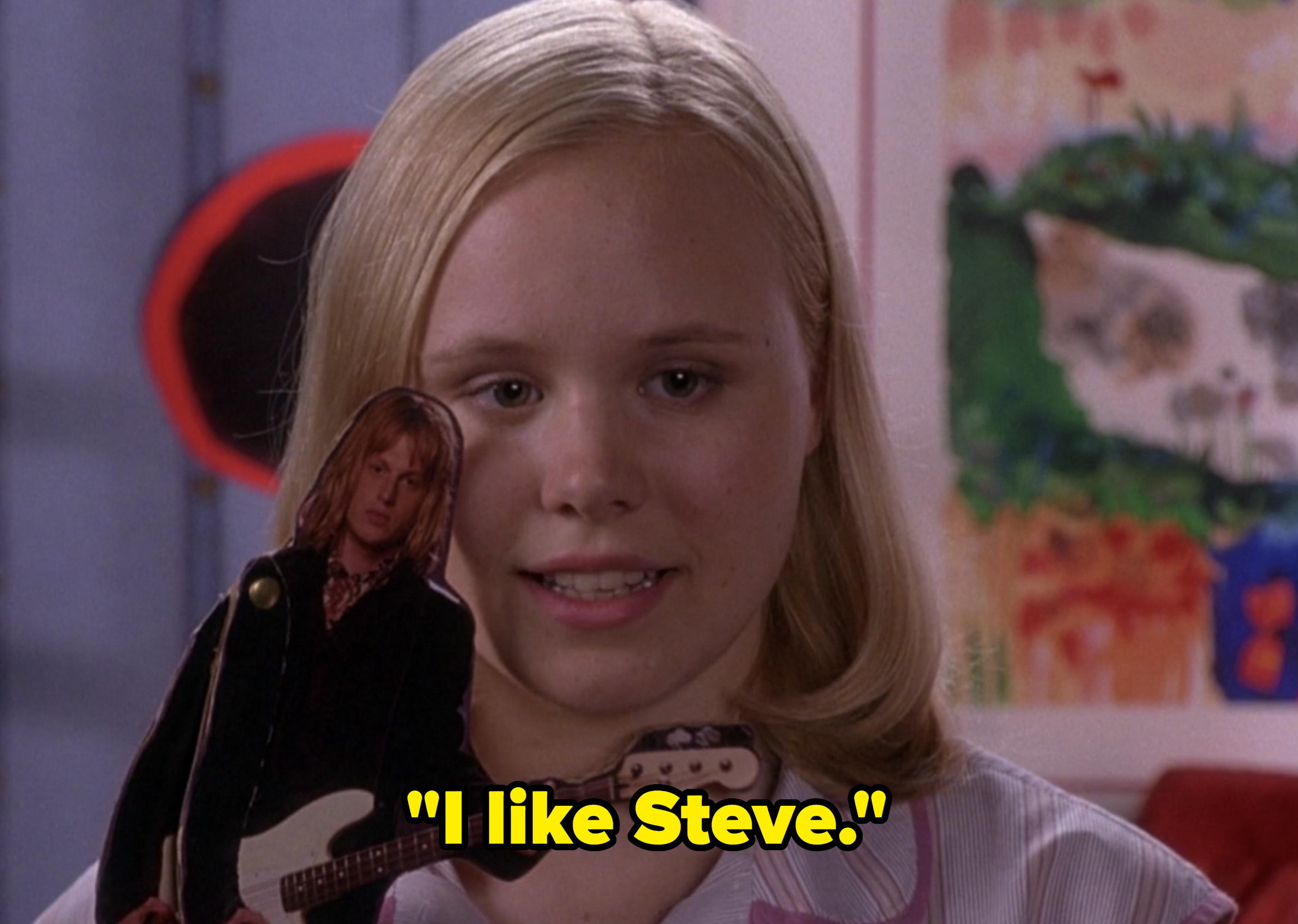 "Alison Pill holds up a tiny cutout of Steve from Sidarthur as Ella in ""Confessions of a Teenage Drama Queen"""