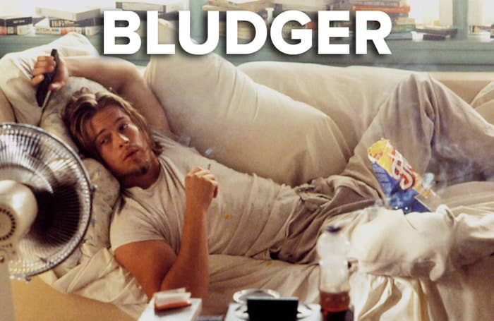 Brad Pitt lounging around on a soft, smoking and eating a bag of chips