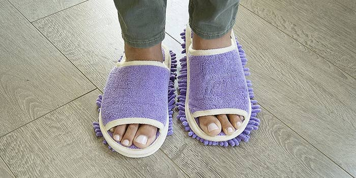 A person wears a pair of slipper that dust the floor