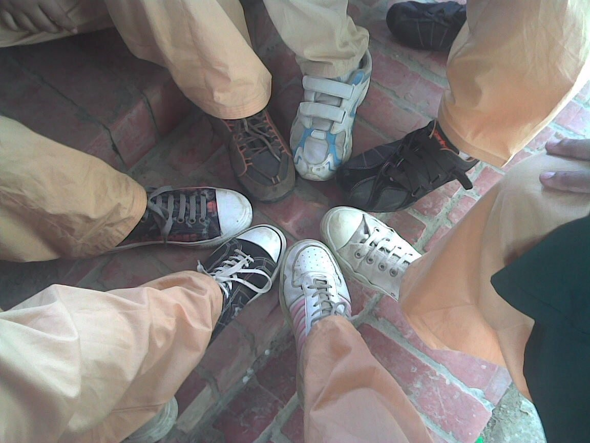 six feet in a circle all wearing converse