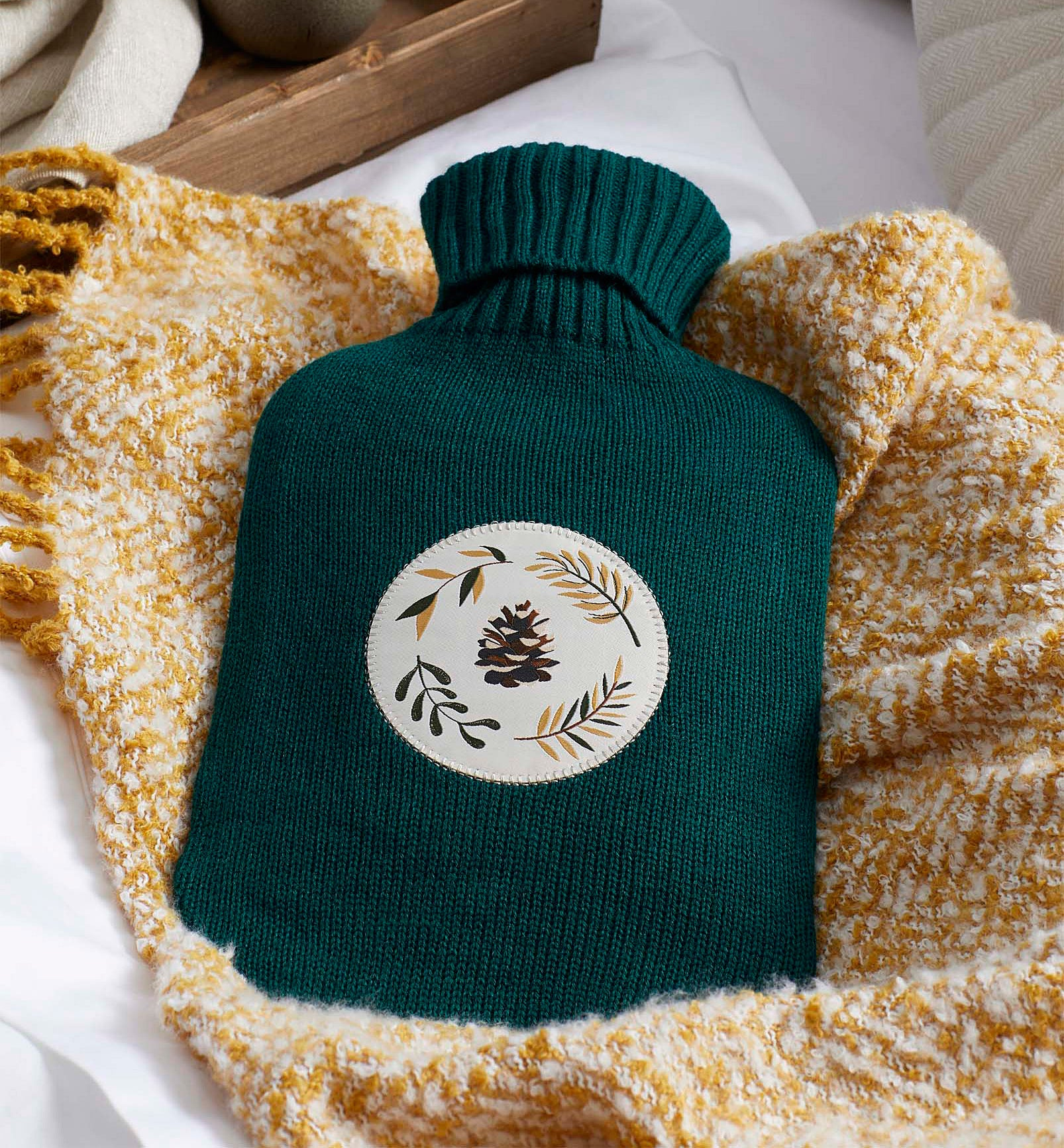 The hot water bottle on a fluffy blanket