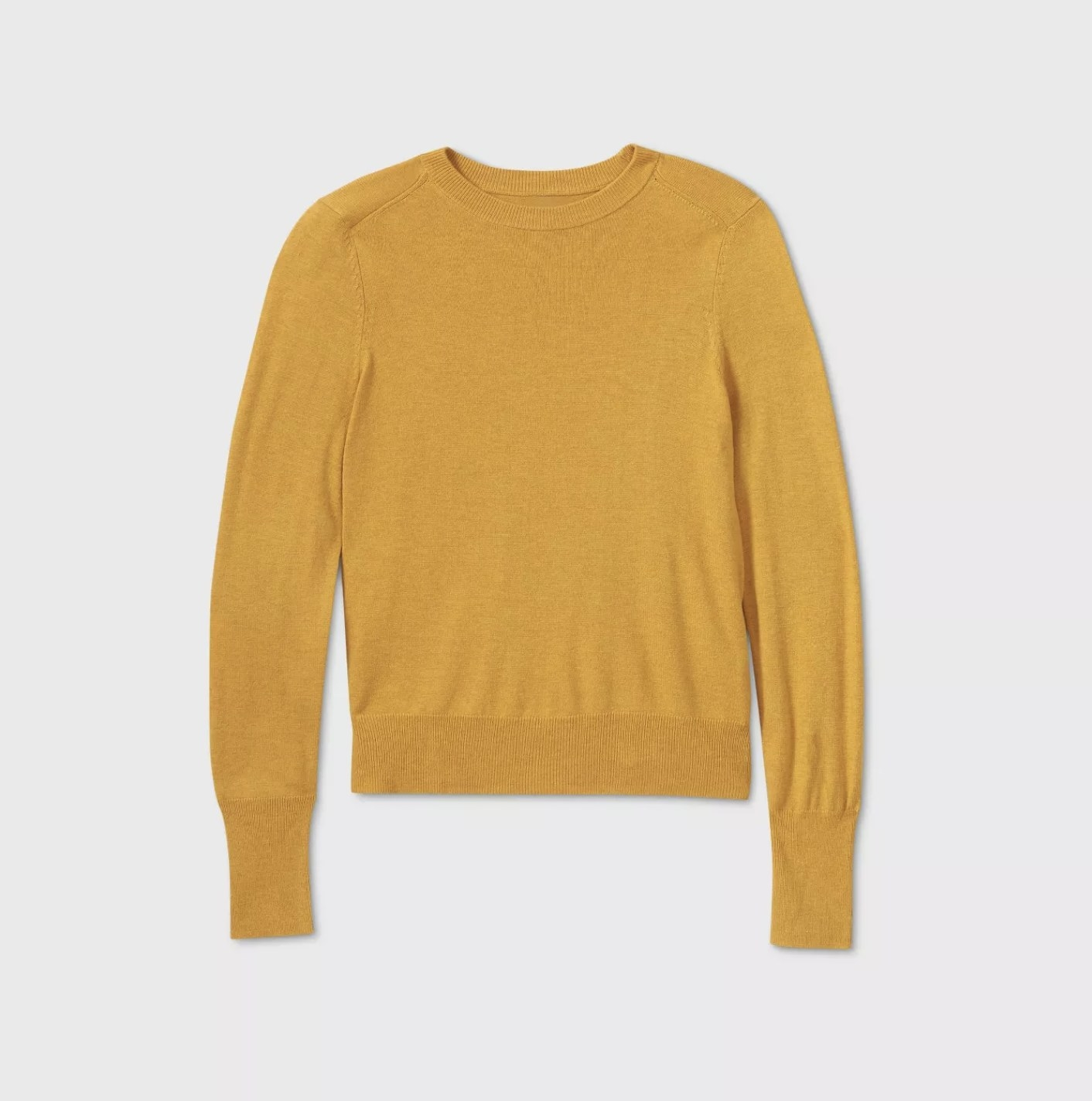 A mustard yellow crewneck pullover sweater