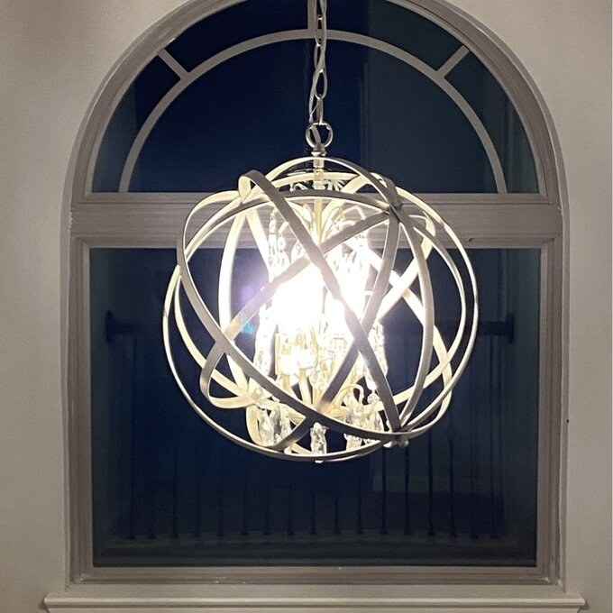 Reviewer's photo of the globe chandelier with metal accents