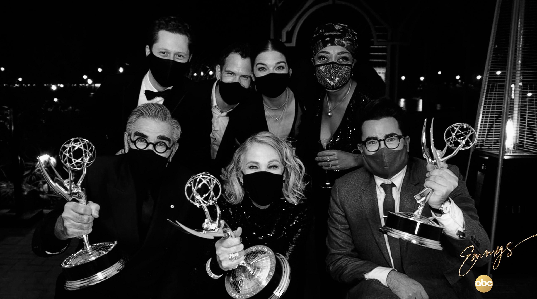 The cast of Schitt's Creek holding their Emmy Awards