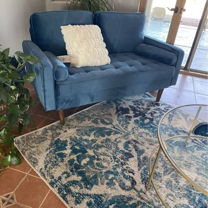Reviewer's photo of the quilted velvet loveseat  in light blue