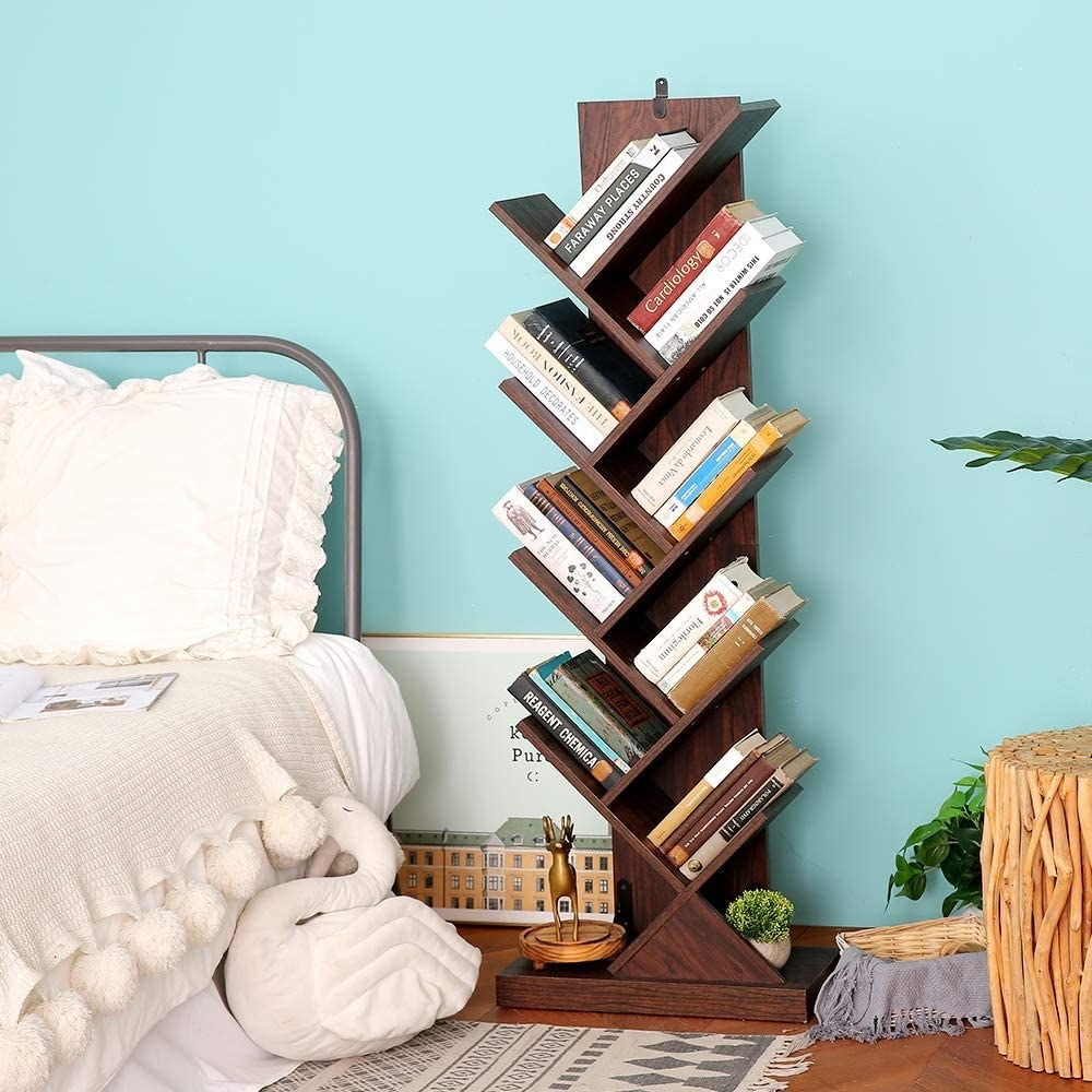 The product holding books in a bedroom
