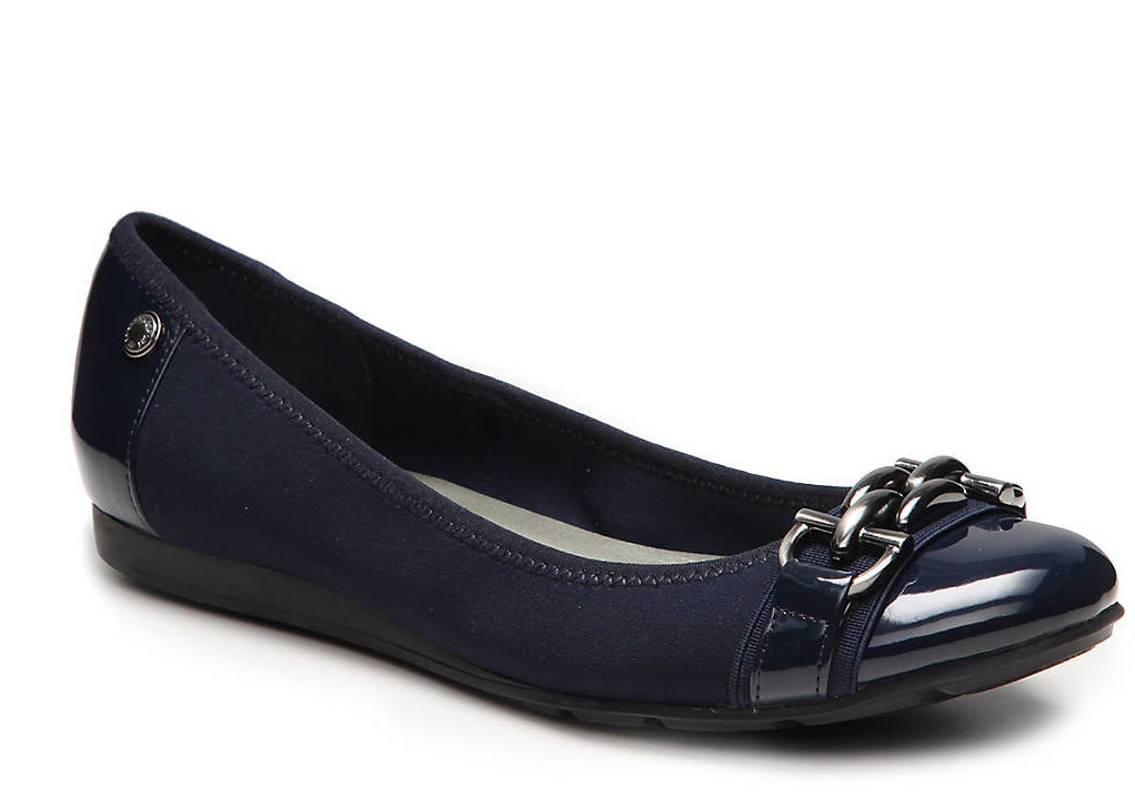 The navy flats with a rubber sole and silver chain detail on the faux-patent cap toe