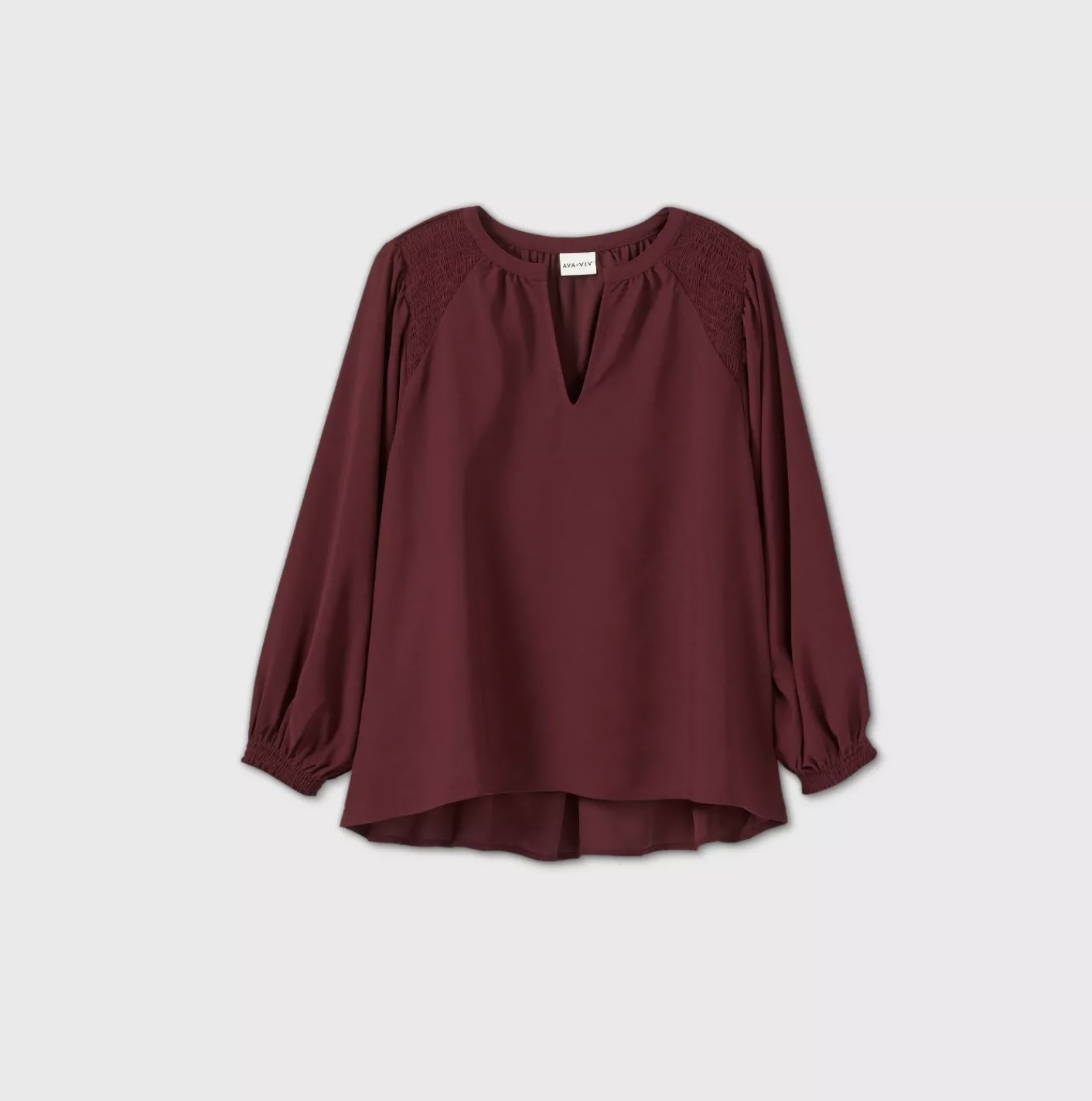 A burgundy blouse with billowy sleeves and a v-neckline