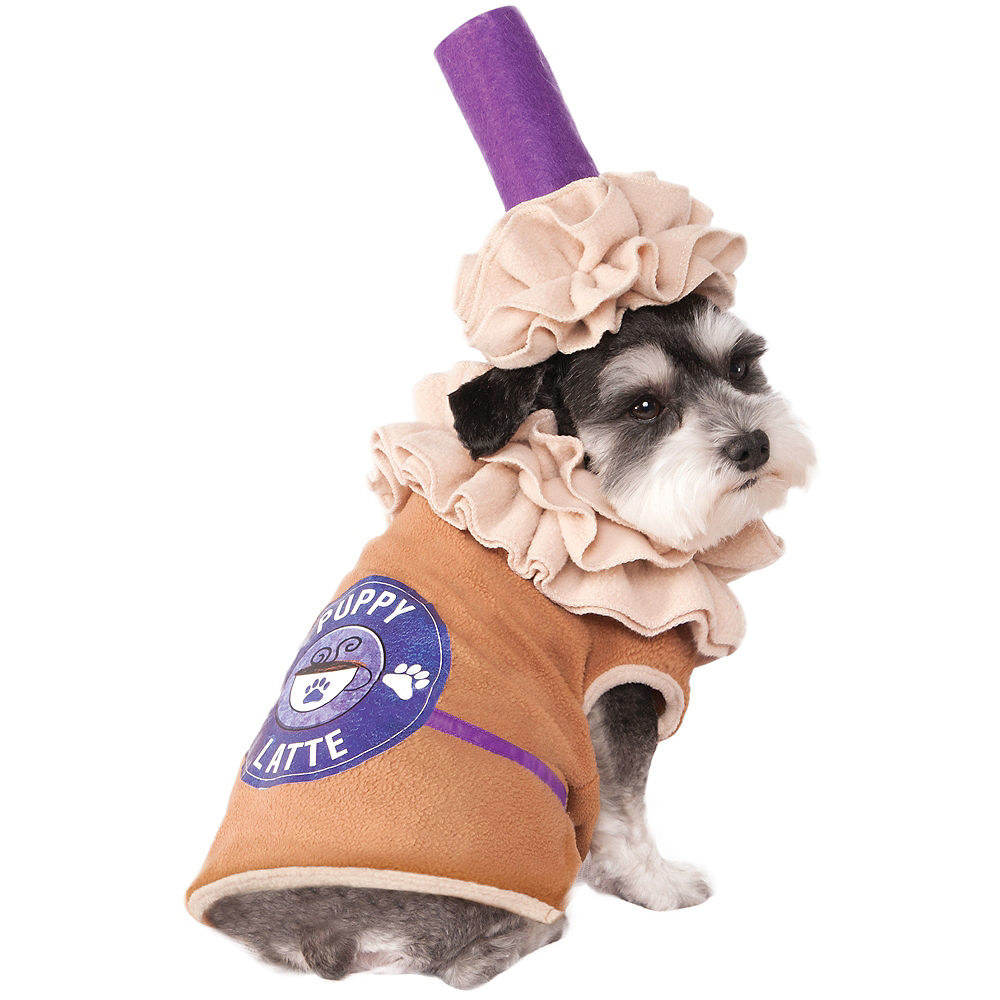 "a dog wearing a brown vest with a ""puppy latte"" label on a hat designed to look like whipped cream and a straw"