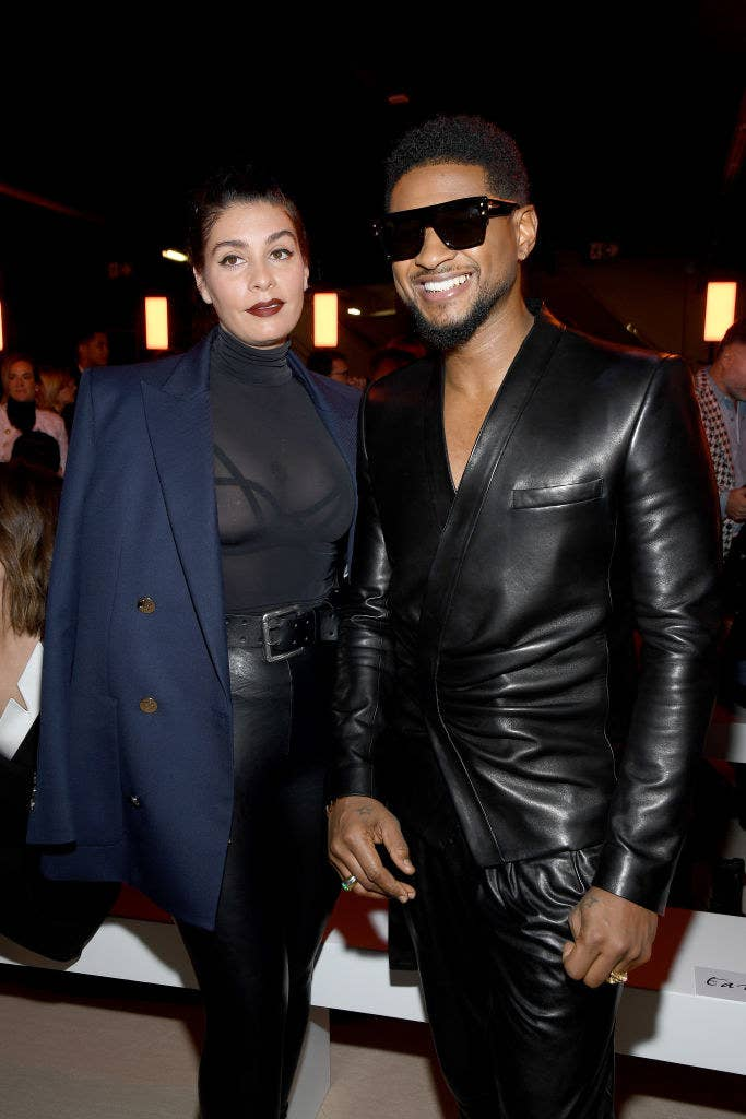 Usher smiling with his girlfriend Jenn