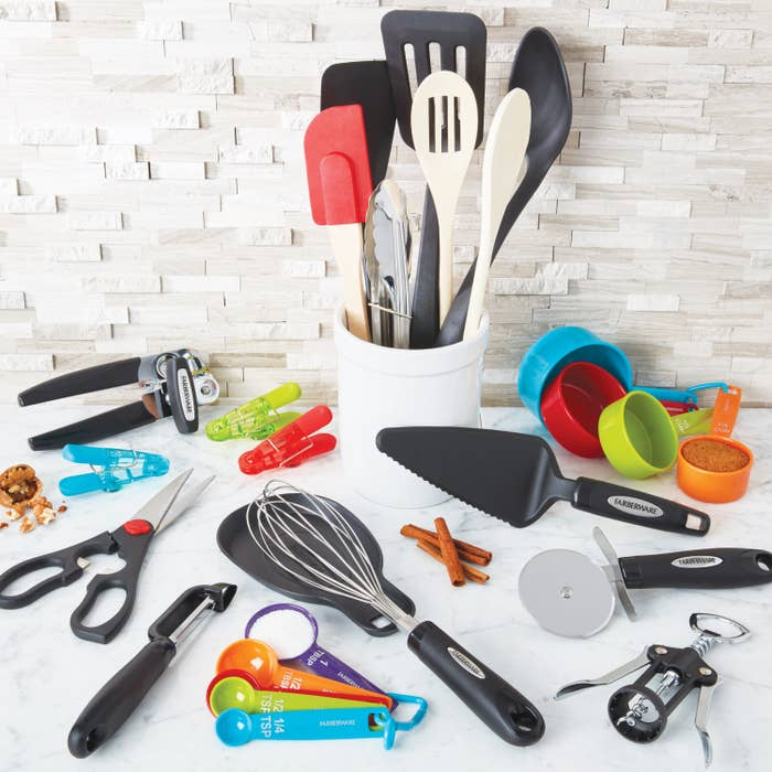 28 pieces of kitchen utensils and gadgets on a kitchen counter