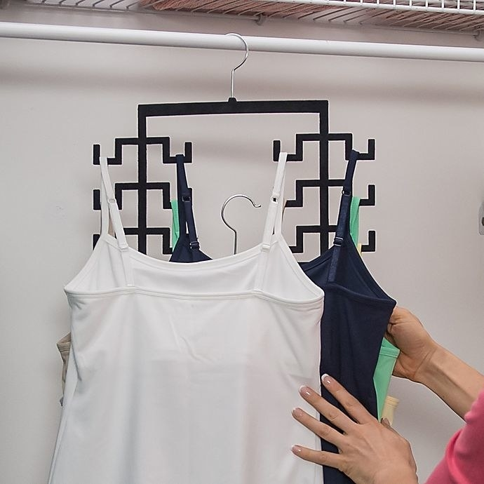 Spaghetti strap shirts hanging on the product