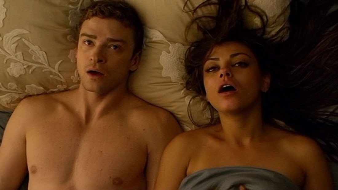 Two people in bed together