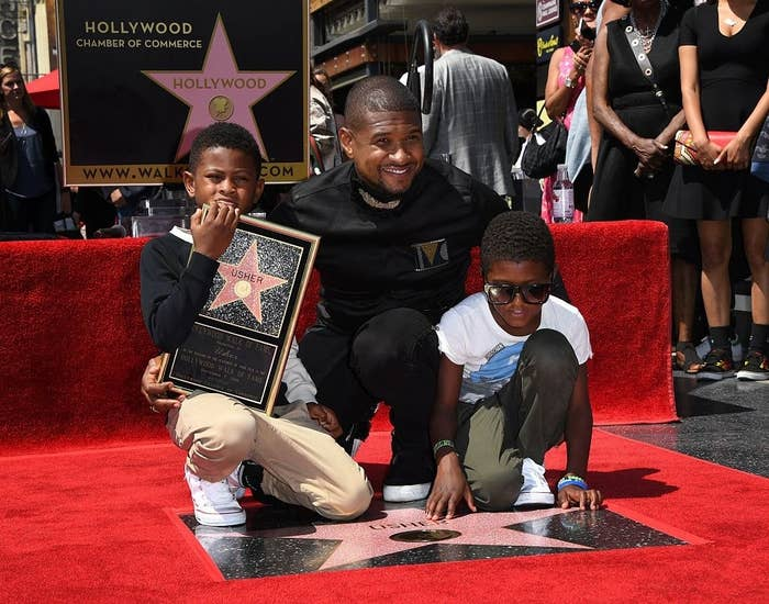 Usher with his sons on his Hollywood star