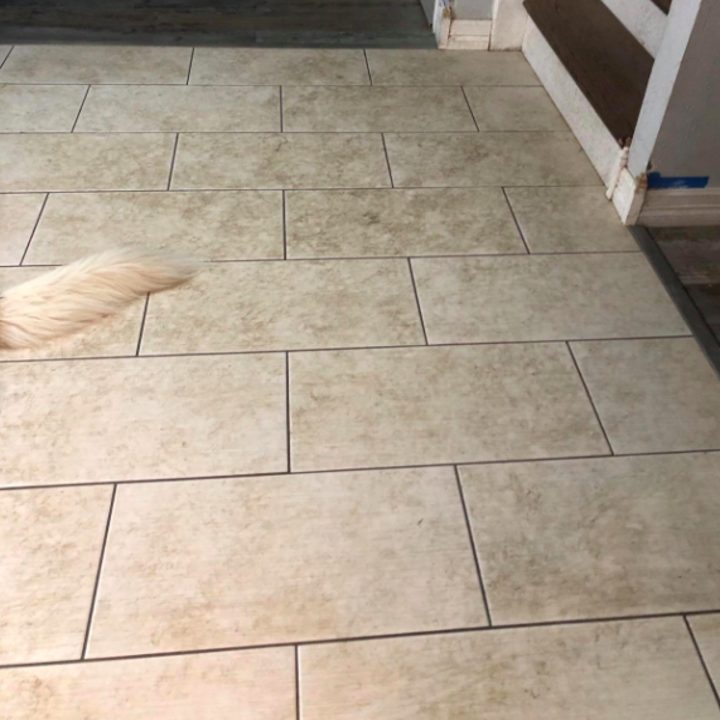 A reviewer's tile floor looking dirty