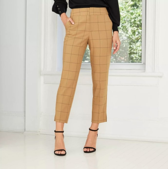 Model wearing yellow plaid pants with heels