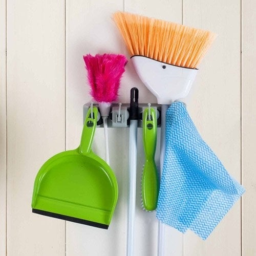 Gray broom and mop holder
