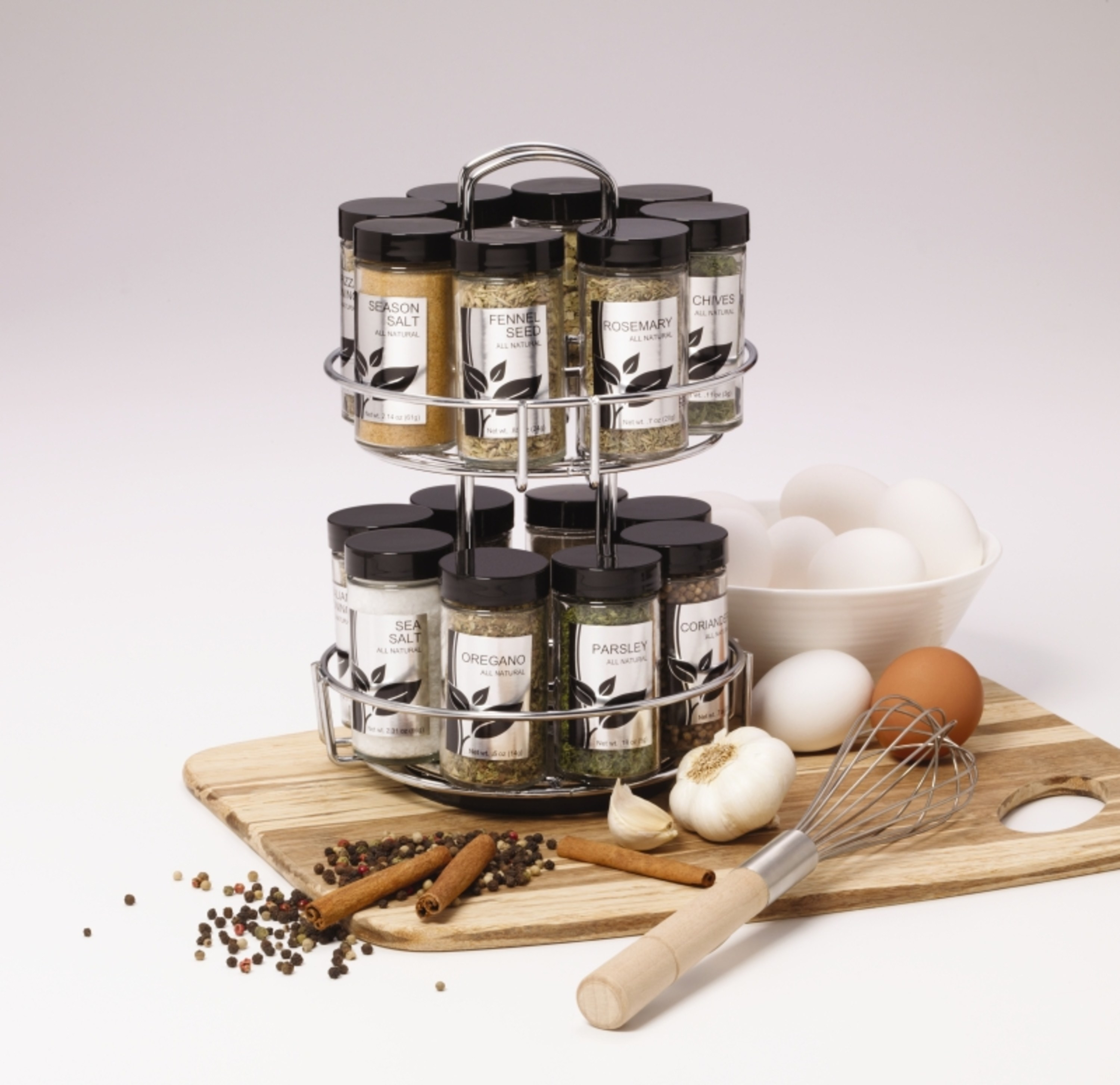 revolving spice rack with 16 spice jars on a cutting board