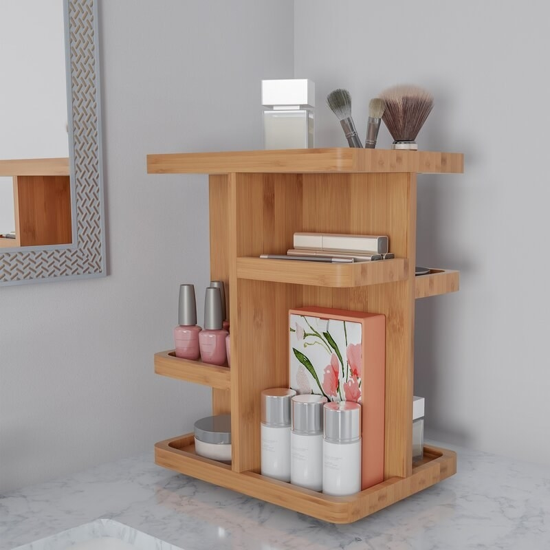 a bamboo rotating makeup organizer that holds skincare, nail, and makeup products