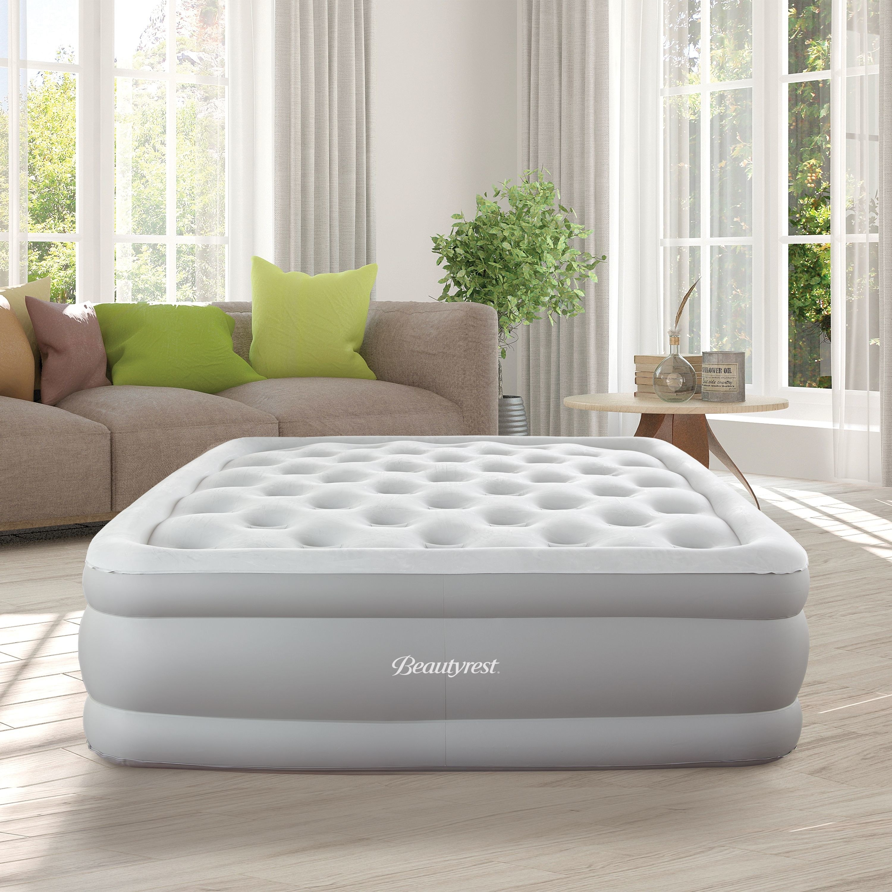 gray beautyrest air mattress inflated in the middle of a living room