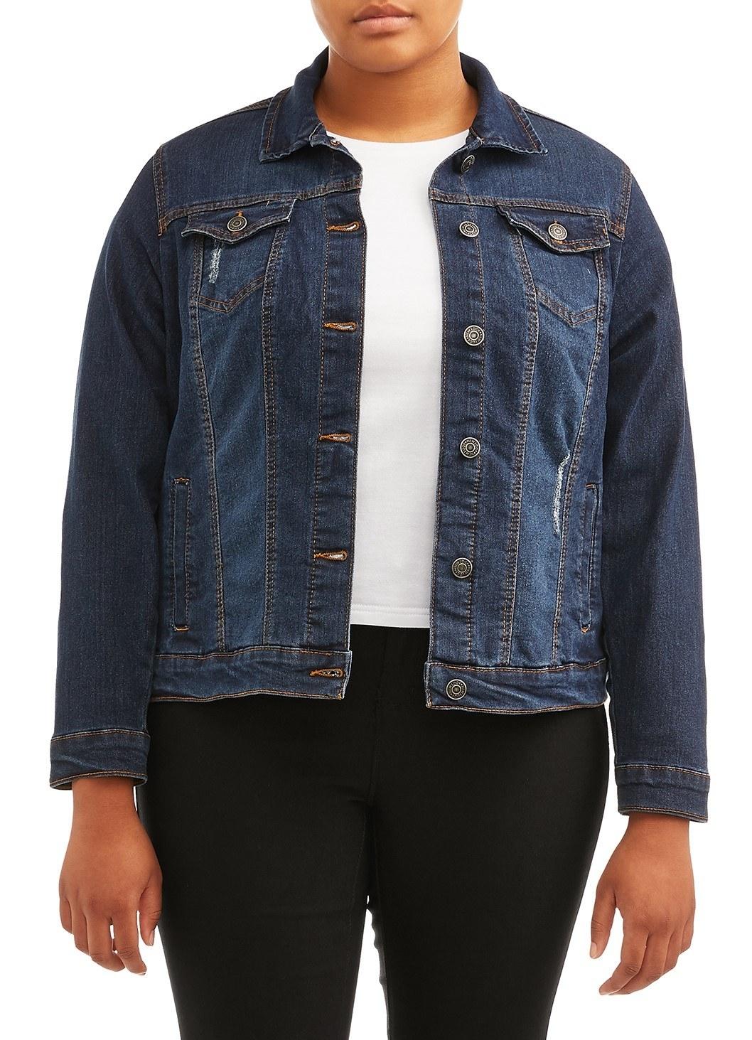 Model wears distressed denim jacket in dark wash