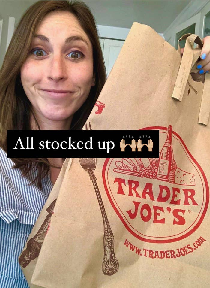 The author holding a Trader Joe's bag after grocery shopping.