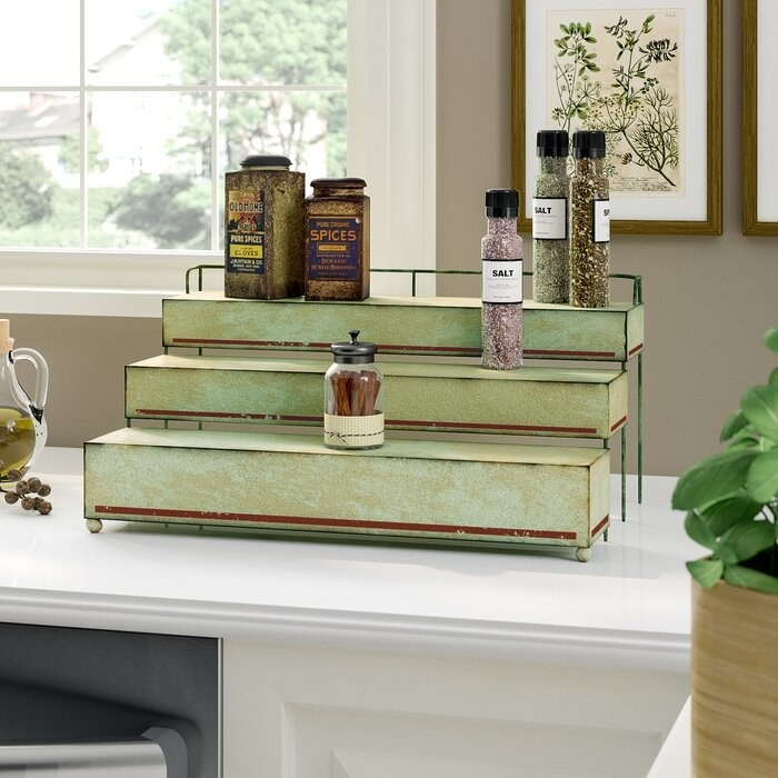 The Laurel Foundry Modern Farmhouse spice rack in a decorated kitchen