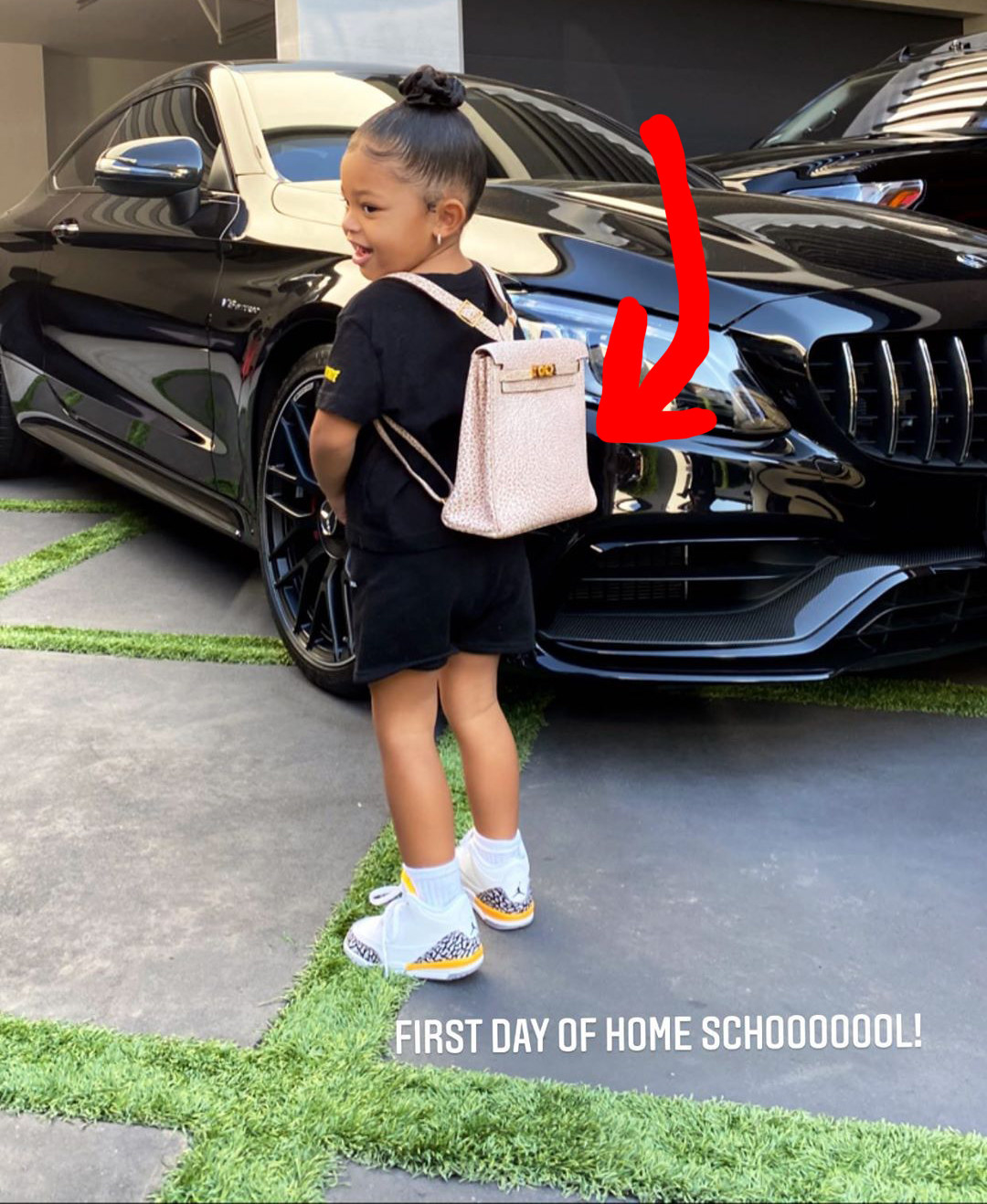 Stormi Webster wearing an Hermes backpack