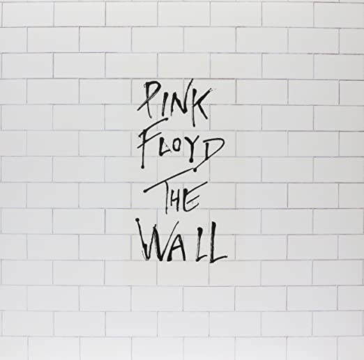 album cover of The Wall showing a brick wall with the name of the band and album written over it