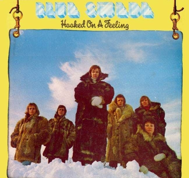 album cover of Hooked on a Feeling showing Blue Swede in fur coats in the clouds