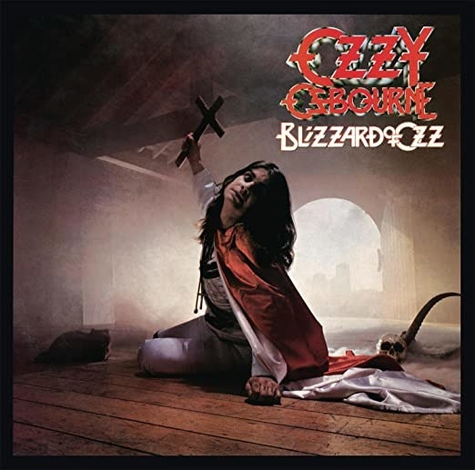 album cover of Blizzard of Ozz with Ozzy Osbourne holding a cross as he sits on the floor