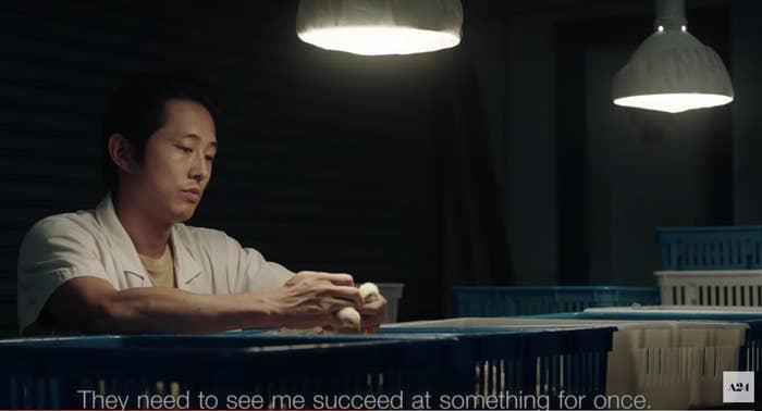 Steven Yeun as Jacob in the film Minari