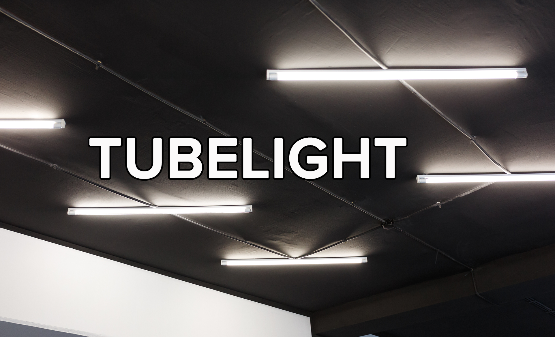 Several illuminated tubelights on a ceiling